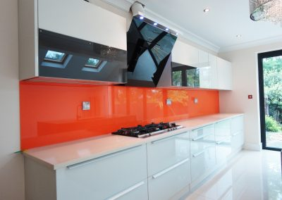 bright orange kitchen splashback