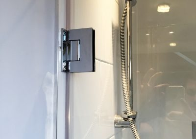 shower door close up with hinge
