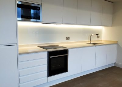 white led lit glass kitchen splashback