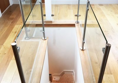 Loft balustrade looking down stairs clear toughened glass