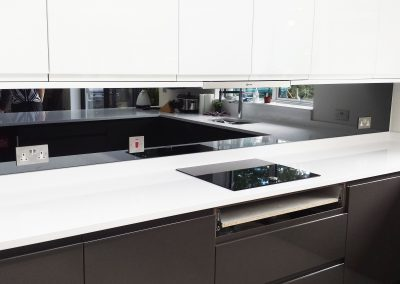 large grey mirror splashback