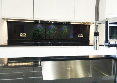 rainbow glitter on black splashback