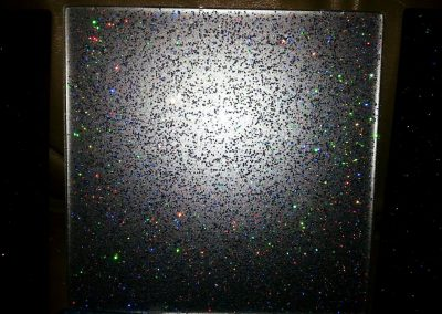 rainbow glitter on glass splashback