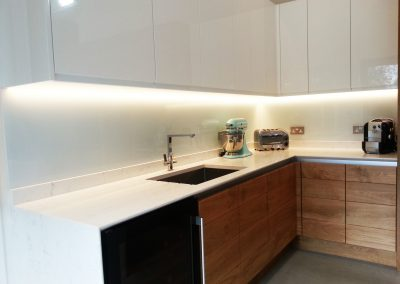 white splashback with led lighting strip